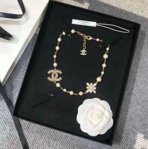 CHANEL Jewelry - Chanel Metal, Resin & Glass Pearls Gold Necklace
